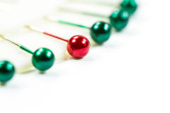 Green and red pushpin Royalty Free Stock Photography