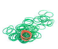 Green and red rubber bands against isolated Royalty Free Stock Images