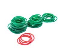 Green and red rubber bands against isolated Stock Photos