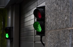Green and Red Stop Light in garage enter. New modern Stock Photography
