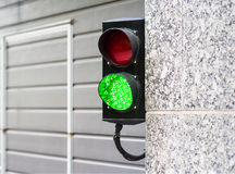 Green and Red Stop Light in garage. Enter new modern Stock Images