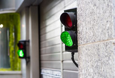 Green and Red Stop Light in garage. Enter new modern Royalty Free Stock Photography