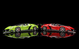 Green and red supercars on black Royalty Free Stock Photo