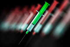 Green and red syringes Stock Image