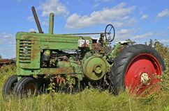 Green and red tractor Royalty Free Stock Images