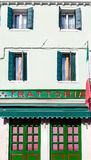 Green and Red Trattoria in Burano Stock Photo