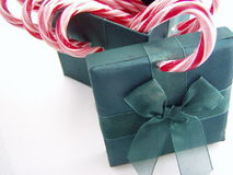 Green, red, and white. Macro of a green wrapped box with candy canes royalty free stock photo