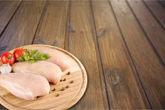 Raw turkey breasts with vegetables on cutting. Green red white background shot studio fresh Royalty Free Stock Photography