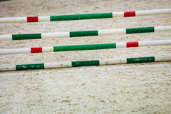 Green red white obstacle for jumping horses. Riding competition. Stock Photos