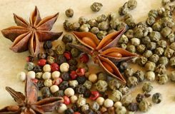 Green, red and white peppercorns close up. Green, red and white pepper on the kitchen board Royalty Free Stock Photos
