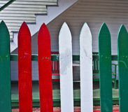 Green, Red, and White Wooden Fence, California. A green, red and white picket wooden fence, painted in the colors of the Italian flag, in Little Italy, San Diego stock image