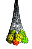 Green, red and yellow apples in in mesh bag  Stock Photos
