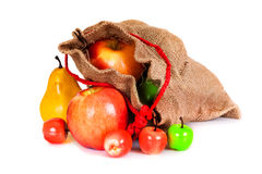 Green, red and yellow apples in sackcloth bag Stock Photo