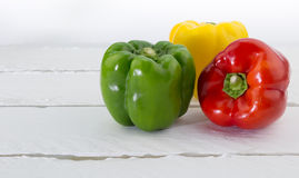 Green, Red and Yellow  Capsicum  on white background Royalty Free Stock Images