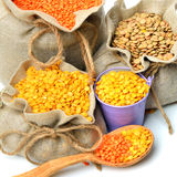 Green, red and yellow lentils in the sacks and spoon wooden isol Stock Image