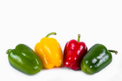 Green red and yellow peppers in a row Stock Image