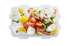 Green red yellow sweet pepper chilly and onion in plastic box container Stock Photography