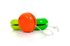 Green and red yoyos on a white background. With copy space Royalty Free Stock Images