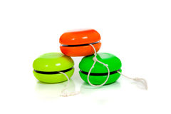 Green and red yoyos on a white background. Green and red yo-yos on a white background with copy space Royalty Free Stock Photos
