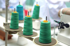Green reels of thread at tailor's. Close up shot of green reels of thread at tailor's Royalty Free Stock Images