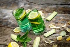 Green refreshing juice - green vitamin drink Stock Photography