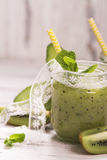 Green refreshing smoothie with kiwi, cucumber and apples stock photo