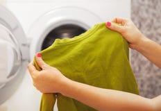 Green reglan in hands of woman Stock Images