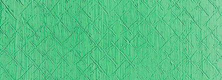Green relief on the wall. Retro plaster on wall with a patterned relief in a hallway of an old house Royalty Free Stock Photo