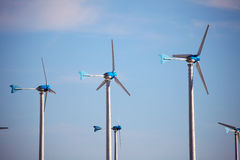 Green renewable energy concept - wind generator turbines Royalty Free Stock Image