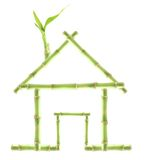 Green Renewable Energy House. Green bamboo house isolated on white: suitable for renewable, clean energy, construction, healthy living themes, recycling Royalty Free Stock Photography