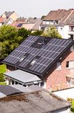 Green Renewable Energy with Photovoltaic Panels. On the Roof Royalty Free Stock Images
