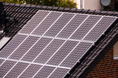 Green Renewable Energy with Photovoltaic Panels. On the Roof Royalty Free Stock Photo