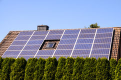 Green Renewable Energy with Photovoltaic Panels. On the Roof Stock Images
