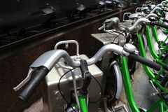 Green Bicycles for Rental in the City. Green Rental Bicycles for servicing tourists normally available in the city area Stock Photos