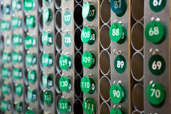 Green repeated numbers on a wall Stock Images