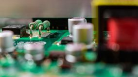 Green resistors on television board stock photos