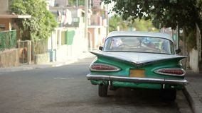 Green retro car at city street. In sunny day stock video