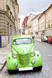 Green retro car on the old streets of Lviv, Ukrain Stock Photo