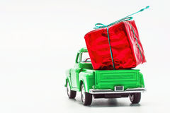 Green retro car pickup with a red gift box isolated.  Stock Photography