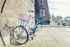 Green retro parked bicycle on a street in Copenhagen. Danmark Royalty Free Stock Image