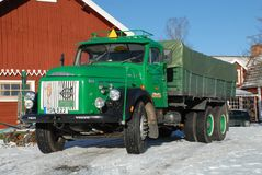 Retro Volvo truck from 1972 on snowy roads. Green Retro veteran Volvo truck N88 from 1972 on snowy winter roads in south of Sweden`s countryside Stock Images