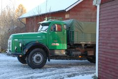Retro Volvo truck from 1972 on snowy roads. Green Retro veteran Volvo truck N88 from 1972 on snowy winter roads in south of Sweden`s countryside Royalty Free Stock Photo