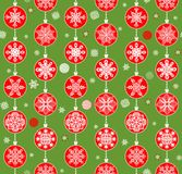 Green retro xmas wrapper with red baubles Stock Photos