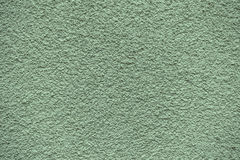 Green revetment wall putty macro texture Royalty Free Stock Photography