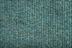 Green Ribbed Fabric Background. Close up of a green ribbed carpet royalty free stock image