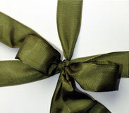 Green ribbon. Over cardboard box for present Stock Photography