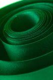 Green ribbon. Green curly satin ribbon close-up Royalty Free Stock Photography