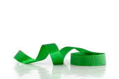 Green ribbon. Against the white background Stock Image