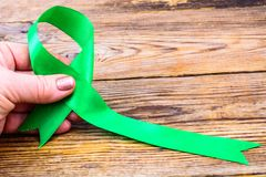 Green ribbon as symbol of awareness of the disease, World Health Day. Studio Photon Stock Images