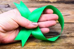 Green ribbon as symbol of awareness of the disease, World Health Day. Studio Photon Royalty Free Stock Image